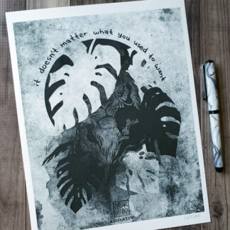 "BW art print featuring a tiger obscured by monstera with the text ""it doesn't matter what you used to want"""
